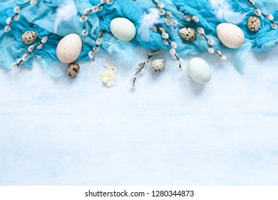 Easter decoration natural eggs and pussy willow. Top view, close up, flat lay on white wooden background