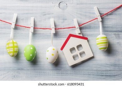 Easter decoration over light wooden background.
