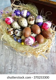 Easter decoration, quail eggs and chocolate eggs on the table