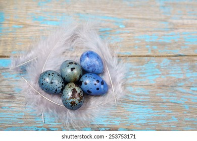 Easter decorations. Eggs on wooden background