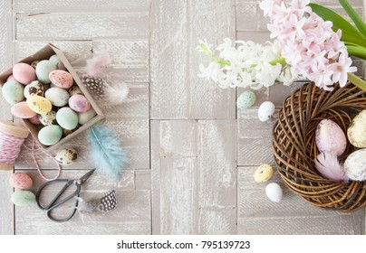 Easter decorations on a rustic wooden background