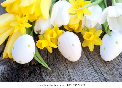 Easter decorations on wooden ground