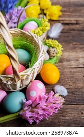 Easter decorations  on wooden table, colored eggs and flowers
