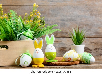 Easter decorative background on wooden floor