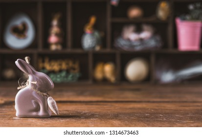 Easter decorative bunny on a wooden background.