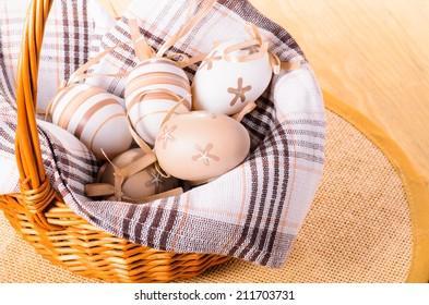Easter decorative eggs un the wicker basket