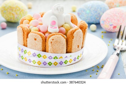 Easter dessert for children: colorful candy treats with cookies and fondant white bunny selective focus