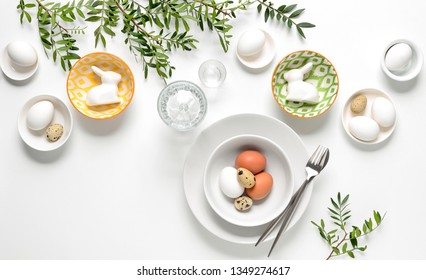 Easter dinner table setting, home holiday decor concept, view from above, blank space for a text