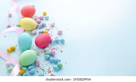 Easter dyed eggs and candies. Web banner image with copy space