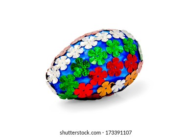 Easter egg blue with sparkles in the form of red, white, orange and green colors isolated on white background