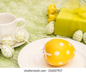 Easter egg table setting, green and yellow color themed