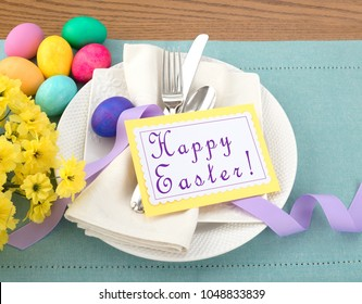 Easter Egg Table Setting with Menu or Invite Card with room or space for your words, text, copy, A horizontal flat layout with plate, silverware, flowers, and napkin from above looking down view.