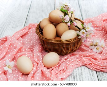 Easter eggs and apple blossom on a old wooden background