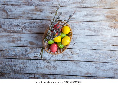 Easter eggs in a basket on a wooden table