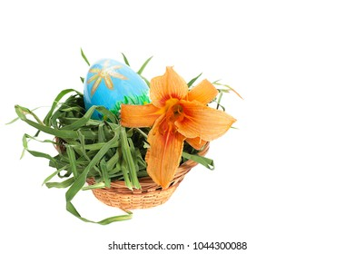 easter eggs in basket with orange lily flower isolated on white background