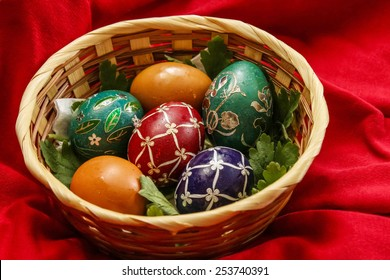 Easter eggs in basket - red background