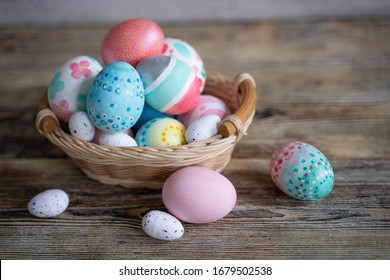 Easter eggs in baskets on wooden background