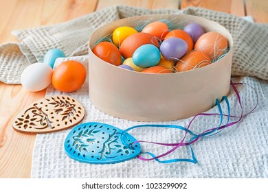 Easter eggs in the box with sisal and Easter decorations.