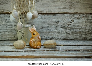 Easter eggs and Easter bunny on a gray background - Easter composition. Mass production of plastic easter eggs and  decorations -  Selective focus