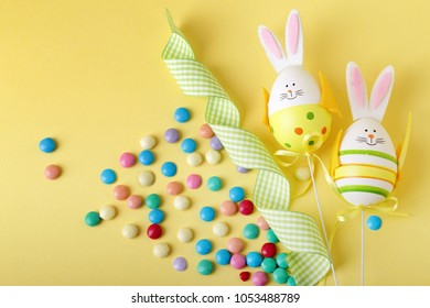 Easter eggs with bunny ribbons and candies