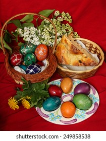 Easter eggs, cake and flowers - red background