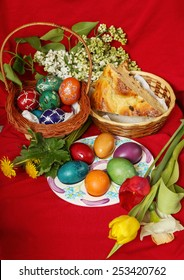 Easter eggs with cake and flowers - red background