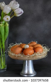 Easter eggs in the cake stand. Tulips. Spring.