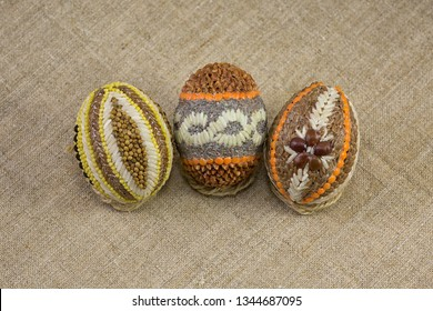 Easter eggs from cereals and grains on the background of burlap
