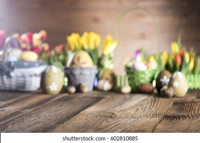 Easter eggs. Colorful bokeh, place for typography and logo. Rustic wooden table. Easter theme.