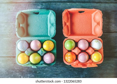 Easter eggs in colorful egg cups