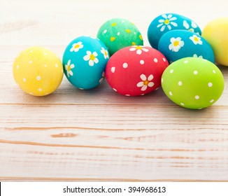 Easter eggs. Colorful Easter eggs on white wooden desk selective focus. Top view, horizontal.