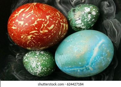 Easter eggs in dark plate