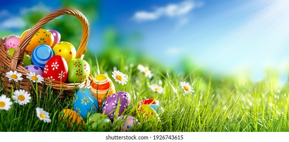 Easter eggs decorated with flowers in the grass - Shutterstock ID 1926743615