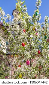 Easter eggs decorated on blooming tree on a сhurch background