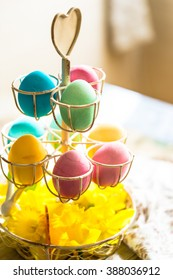 Easter eggs in decorative tray with narcissus flowers