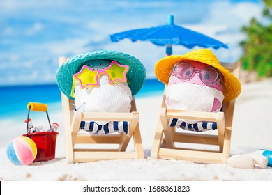 Easter eggs with faces mask at beach. Travel concept. Protection from corona virus.