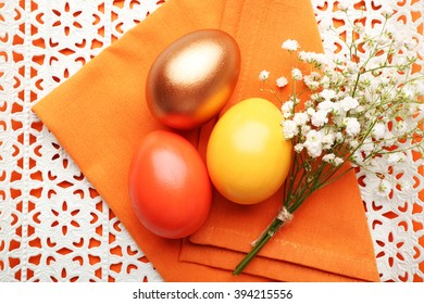 Easter eggs and flower composition, top view