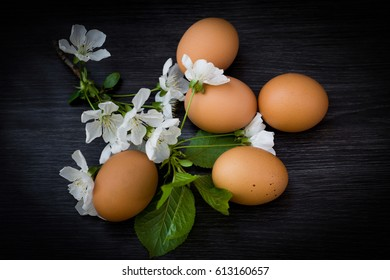 Easter eggs and flowers on wooden background. Happy Easter.