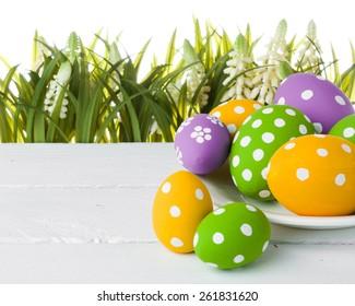 easter eggs hidden in the grass. studio shot