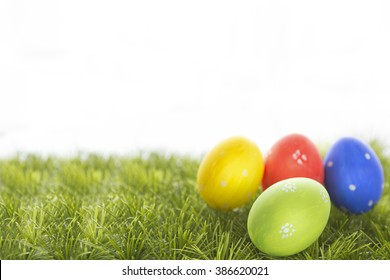 Easter eggs hiding in the grass. Happy Easter.