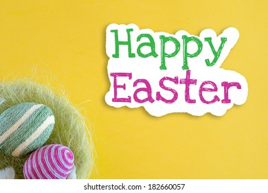 Easter eggs inside basket decorated with woolen threads on yellow background with text Happy Easter