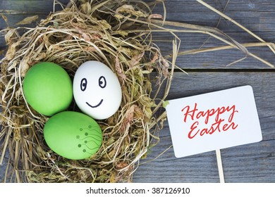 Easter eggs in nest on rustic wooden background, selective focus image, Card Happy Easter