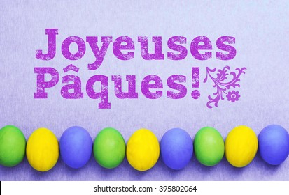 Easter eggs in nest on rustic wooden background, selective focus image, Card Happy Easter - Joyeuses Pâques in French