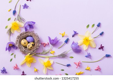 Easter eggs in nest with spring flowers