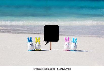 Easter, easter eggs on the beach, sand, ocean and sea