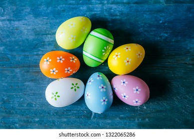 Easter eggs on blue wooden table