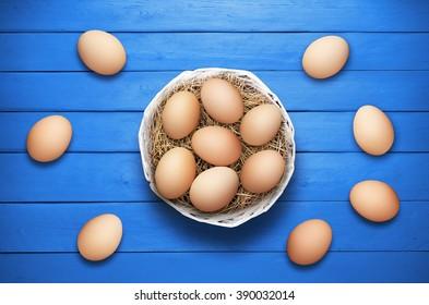 Easter eggs on blue wooden planks