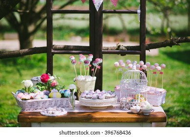 Easter eggs on a decorative table with cakes