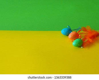 Easter eggs on green and yellow background, place for text