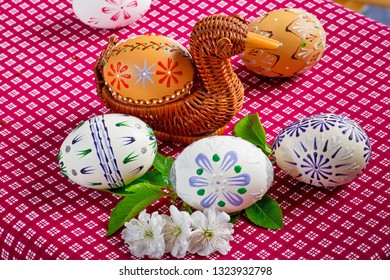 Easter eggs on the red tablecloth